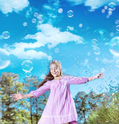 Plexiglas Konrad B. Portrait of a pretty girl dancing among lots of soap bubbles