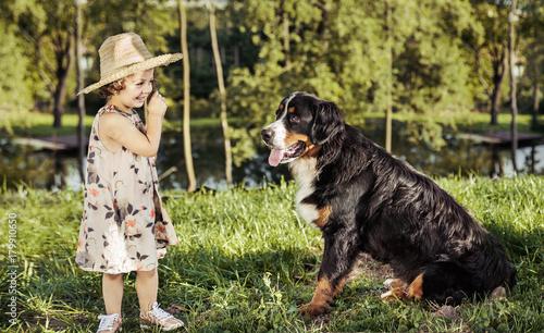 Foto op Canvas Artist KB Portrait of a cute little girl with a friendly dog