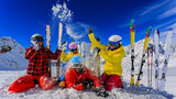 Happy family enjoying winter vacations in mountains. Playing with snow, Sun in high mountains. Winter holidays. - 179913416