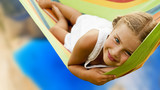 Beautiful teenager girl relaxing in the hammock on tropical beach with turquoise sea water, hot sunny day. - 179913665