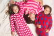 Leinwandbild Motiv Sisters or friends in pajamas sleep in bed, top view