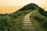 Fairy tale landscape and stepping stone path over a hill on the horizon at the Caoling Historic Trail in Taiwan - 179934407