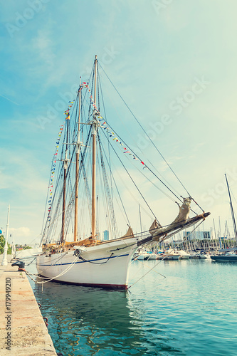 Fotobehang Barcelona Sailing boat on Barcelona harbor