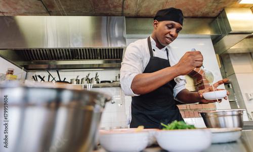 Sticker Chef cooking food in restaurant kitchen