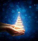 The Magic Of Christmas In Child Hand - 179965871