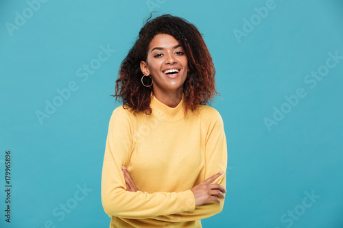 Fotobehang Hoogte schaal Happy pretty young african woman dressed in warm sweater