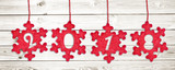 2018 cut in red fabric christmas ornaments hanging on white wooden planks background - 179969401