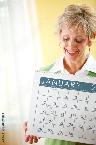 Poster Woman Holding a January 2018 Calendar