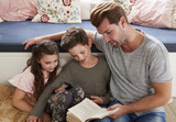 Father Reading Book With Son And Daughter At Home - 179974885