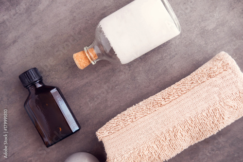 Fotobehang Spa SPA beauty products still life. Body and skincare massaging oil, serum, cream and towel from above. Luxury salon concept
