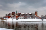 Historic royal Wawel Castle and Cathedral in Cracow, Poland, with Vistula river on a cloudy day in winter. - 179992299