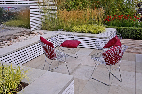 A contemporary garden patio with seating - 179994682