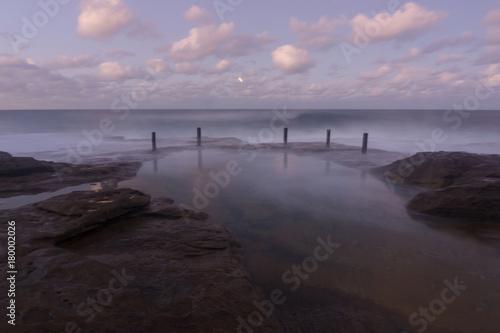 Fotobehang Zee zonsondergang Rock pool - sunset long exposure
