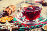 Christmas hot wine or tea drink with orange mandarin star anise cinnamon and gingerbread - 180007254