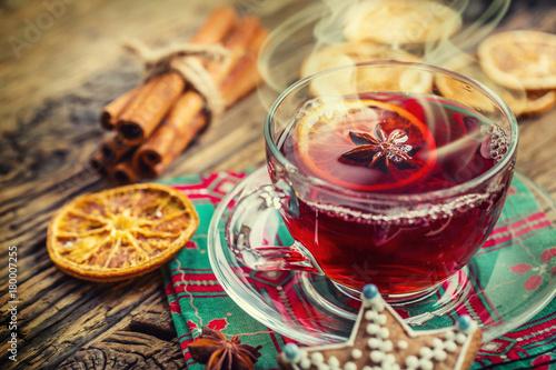 Fototapeta Christmas hot wine or tea drink with orange mandarin star anise cinnamon and gingerbread