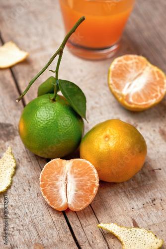Fotobehang Sap Mandarins. Fresh tangerines on a wooden background