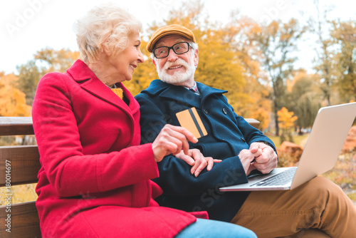 senior couple shopping online - 180014697