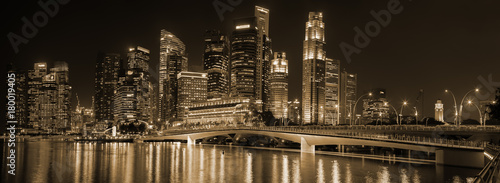 Singapore night downtown skyline panorama. Labels and trademarks blured
