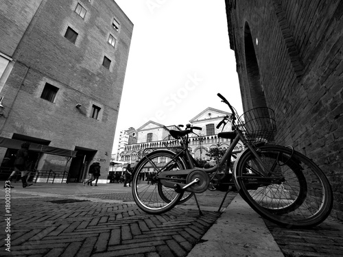 Fotobehang Fiets Two bikes and Ferrara city, Italy