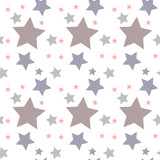 Seamless vector pattern with colored stars of various sizes on white background.