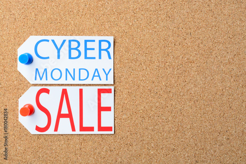 Cyber Monday sale tags are pinned to the cork board