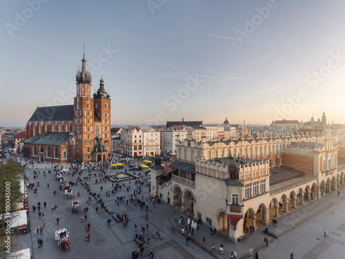 Old city center view in Krakow, aerial drone photography at sunset time, famous cathedral in evening light, the Cloth Hall in Poland