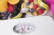 scales with healthy food and tape measure, diet and slimming concept