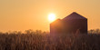 Sunrise over frost covered Corn Fields and Silos
