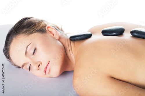 Fotobehang Spa Portrait of a Woman Getting a Hot Stone Massage