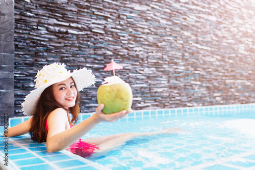 Fotobehang Spa Young asian woman relaxing in swimming pool at spa resort.relaxing concept.