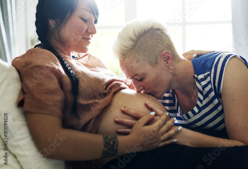 canvas print picture Woman kisses her partner's pregnant belly