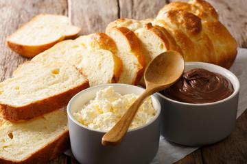 sliced brioche bread and mascarpone cheese and chocolate cream close-up. horizontal
