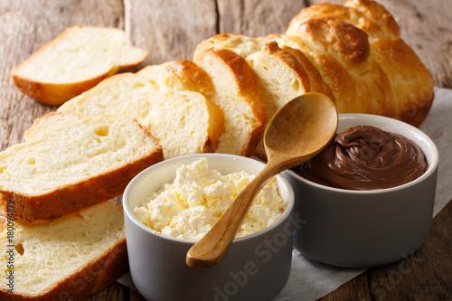Fototapeta sliced brioche bread and mascarpone cheese and chocolate cream close-up. horizontal