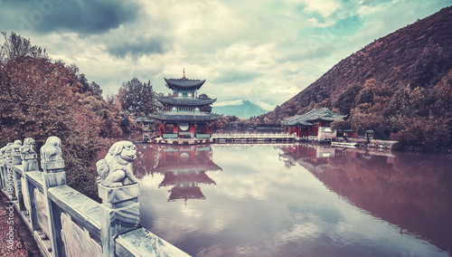 Vintage toned picture of Jade Spring Park in Lijiang, China.