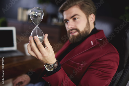 Sticker Businessman playing hourglass at his office