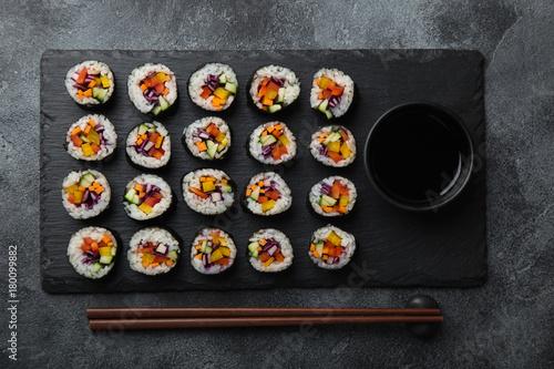 Plexiglas Sushi bar healthy rainbow vegan sushi rolls with fresh vegetables