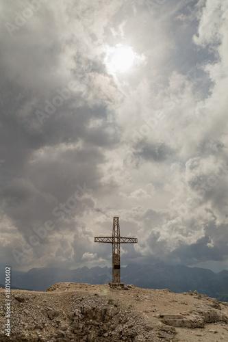 Fotobehang Donkergrijs cross on mauntain top. Passo Pordoi. Dolomites Alps. South Tyrol. Italy
