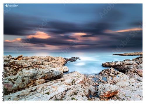 Fotobehang Zee zonsondergang i colori della natura