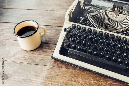 Typewriter And A Mug Of Hot Coffee On A Wooden Table