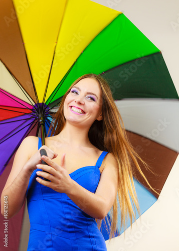 Juliste Woman in summer dress holds colorful umbrella