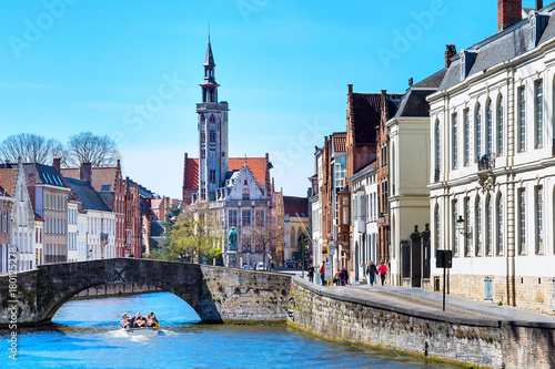 Fotobehang Brugge Panorama with canal and colorful traditional houses against blue sky in popular belgian destination, Bruges, Belguim
