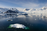 Antarctica snow capped mountains and iceberg landscape