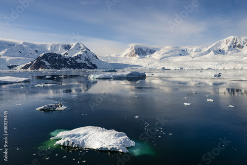 Plexiglas Antarctica Antarctica snow capped mountains and iceberg landscape