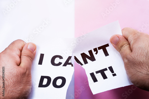 Man cutting with scissors the piece of paper with words I can't do it Poster