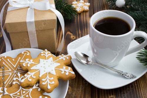 Coffee, Christmas gift and cookies on the wooden background