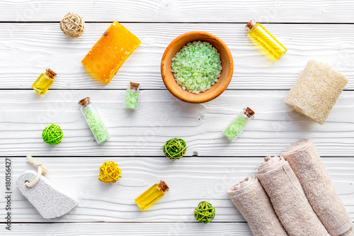 Fotobehang Spa Foot spa cosmetics. Spa salt, pumice stone, soap and towel on white wooden background top view