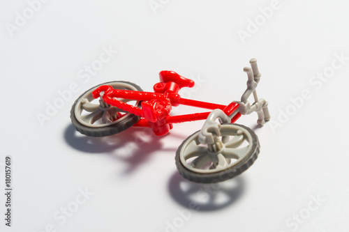 Fotobehang Fiets Small broken toy bicycle