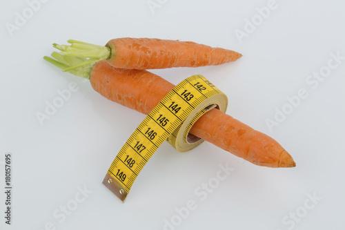 Fotobehang Keuken fresh carrots with measure tape