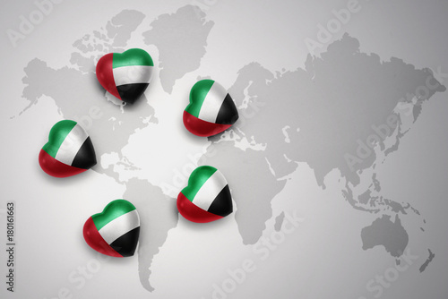 Deurstickers Abu Dhabi five hearts with national flag of united arab emirates on a world map background.