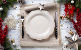 Christmas holiday dinner background; empty dish, cutlery and Christmas tree decoration - 180163257